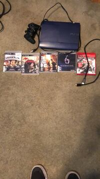 black Sony PS3 slim console with game cases 2172 mi