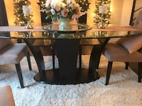 Rectangular glass top table 71 inches long 44 inches depth, normal wear on glass top it is tempered glass , to big for my space