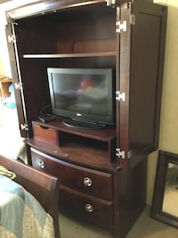 Black CRT TV with brown wooden TV hutch Yulee, 32097