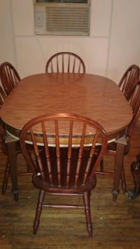oval brown wooden dining table with six chairs  Beaumont, 77708