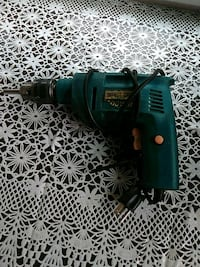 green and black Makita cordless hand drill 2264 mi