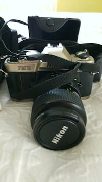 Black Nikon FM 10 film camera with carrying case