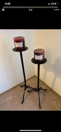 Cast iron candle sticks with candles