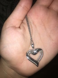 Silver chain link necklace with hear-shaped pendant