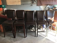 four black leather padded chairs