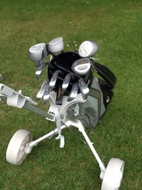 Black and white golf bag with golf clubs. Men's left handed