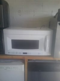 White lg over the range microwave  Kissimmee, 34743