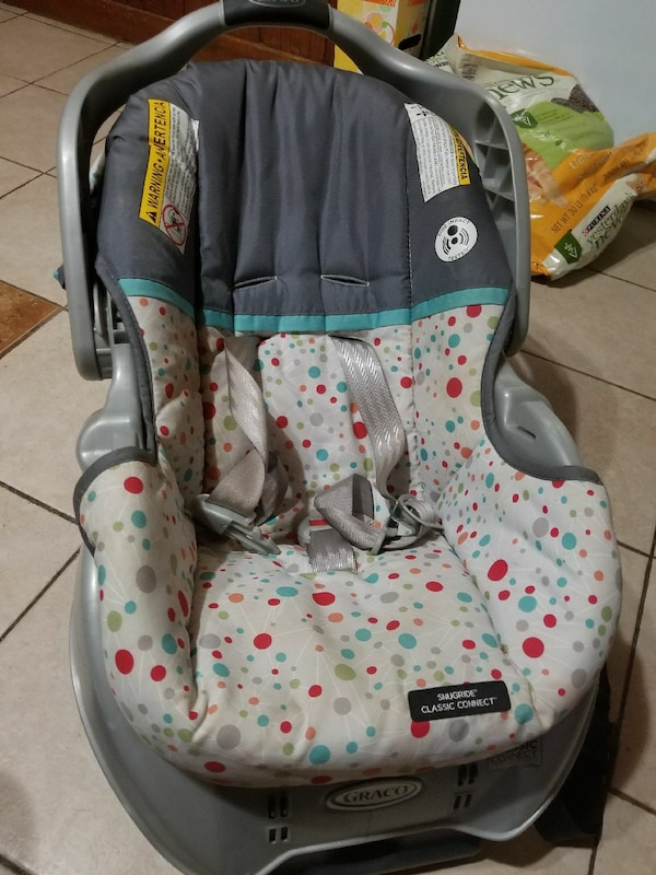 Babys Gray White And Teal Graco Infant Car Seat