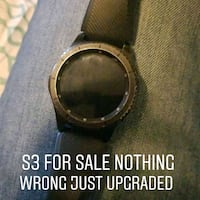round silver-colored watch with black strap Silver Spring, 20903