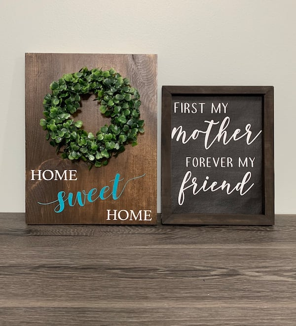 Signs and floral wreath cd650220-582e-430e-be7b-2ddc8924bafc