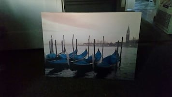 blue 5 boat over body of water picture frame