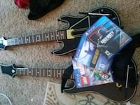 three PS4 game cases and two black guitar game con Lynnwood, 98036