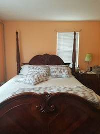 white bedspread and brown wooden bed frame