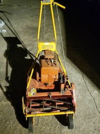 orange and yellow reel mower 1371 mi