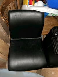 Two Leather Swivel Chairs