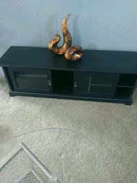 Cabinet below tv or by a couch or in bedroom will go low as 80.00