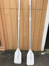 two white boat paddles Salaberry-de-Valleyfield, J6T 2T1
