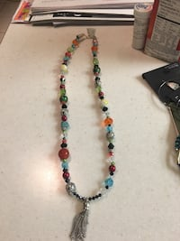 Green, red, and blue beaded hand made necklace  Kenner, 70065