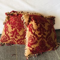Gorgeous maroon set of cushions with beads  trimmings at the end