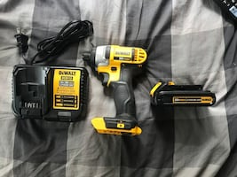 Dewalt DCF885 Cordless Impact Driver with 1.5 AH battery and charger.