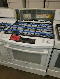 GE slide-In gas range like New four months warrant Baltimore, 21223