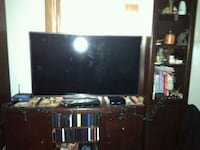 black flat screen TV with black wooden TV stand Anchorage, 99501
