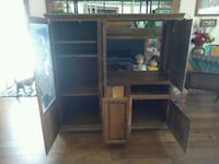 brown wooden TV hutch with flat screen television Hesperia, 92345