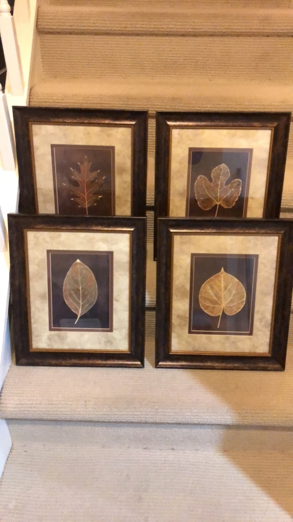 three brown wooden framed paintings of flowers f13f9514-1e83-45f6-a878-bc227b9f9bcf