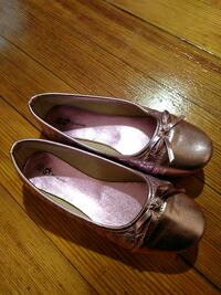 pair of women's gray leather flat shoes with bow a
