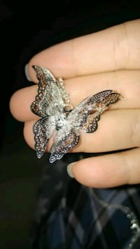 silver-colored butterfly pendant