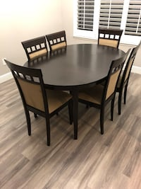 round brown wooden table with four chairs dining set 2376 mi