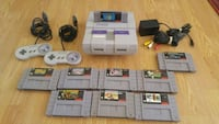 SNES console with controller and game cartridges Bullhead City, 86442