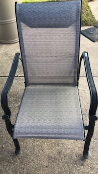 Six metal framed gray padded patio chairs with adjustable backs.  Very comfortable and solid.