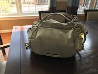 Beautiful Coach purse in pearlized off-white leather. Two tone hardware. Leesburg, 20176