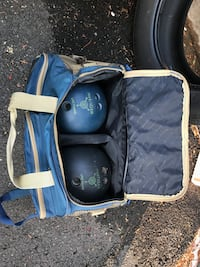 two black and blue bowling balls with bag
