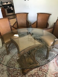 Tommy bahama 5 piece dining set all captain chairs  PORTSAINTLUCIE