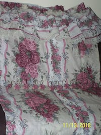 white, pink, and green floral textile Sussex County