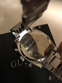 Silver-colored Guess watch with silver-colored link band