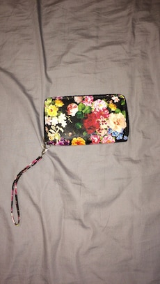 black, red, and white floral wristlet