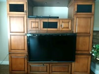 flat screen television with brown wooden TV hutch Temecula, 92592