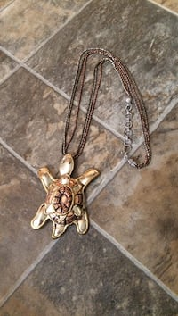 Gold-colored necklace with gold-colored turtle pendant Isleton, 95641