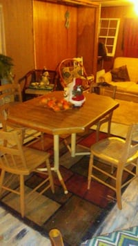 rectangular brown wooden table with four chairs dining set Wilmington, 45177