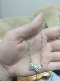 silver-colored chain necklace with bow tie pendant Thorold, L2V 4L1