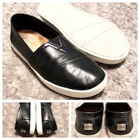 Women's Toms paid $135 size 7.5 Great condition! Leather with metal detail purchased from Neiman Marcus.