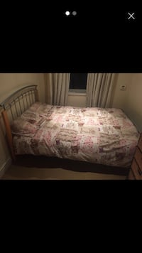 Perfect condition Double bed with metal and wood frame Romford, RM1
