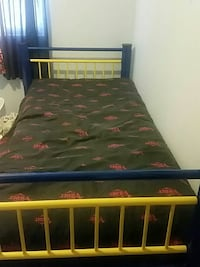 blue and yellow wooden bed frame with green bed sheet Ogden, 84404