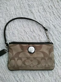 brown and beige monogramemed Coach hobo bag