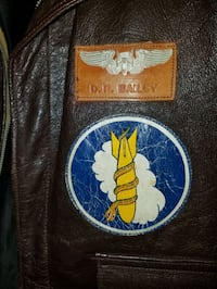 WW2 leather bomber jacket and war plans.