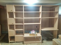 brown wooden TV hutch with shelves