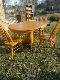 oval brown wooden table with four chairs dining set Windsor, N9G